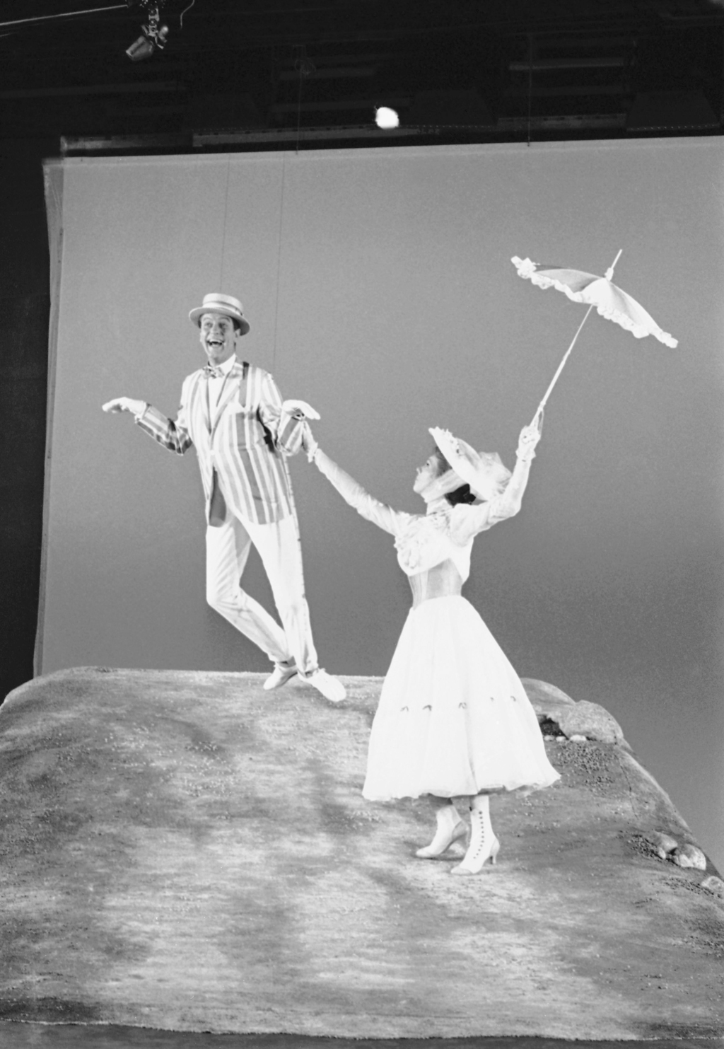 FILE - In this June 25, 1963, file photo, Dick Van Dyke, left, is airborne during a dance with Julie Andrews, right, during the filming...