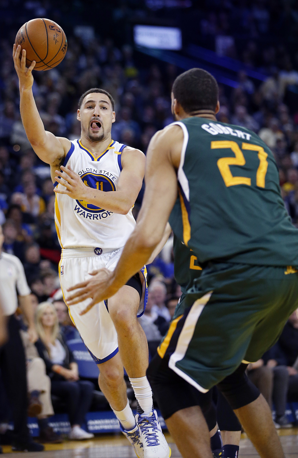 Golden State Warriors guard Klay Thompson (11) drives to the basket against Utah Jazz center Rudy Gobert (27) during the first half of ...