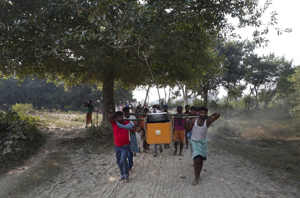 In this Nov. 23, 2016 photo, relatives and villagers carry the coffin of Balkisun Mandal Khatwe at Belhi village, Saptari district of N...