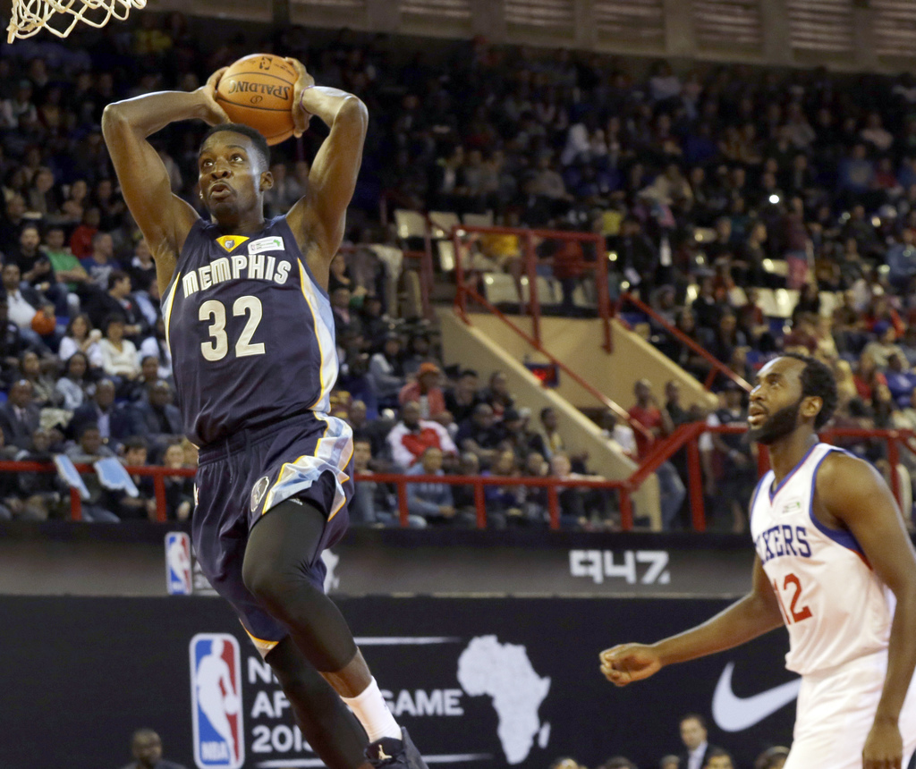 FILE - In this Aug. 1, 2015 file photo, Team World's Jeff Green of Memphis Grizzlies, left, goes up for a shot as Team Africa's Luc Mba...