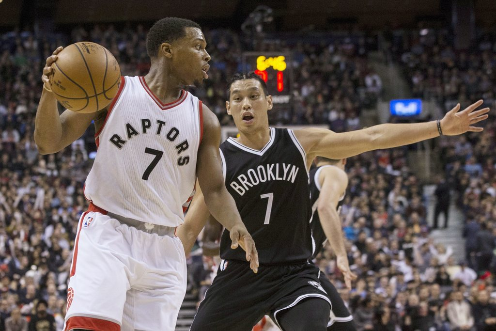 Toronto Raptors guard Kyle Lowry, left, looks to make a play as Brooklyn Nets guard Jeremy Lin covers during second half NBA basketball...