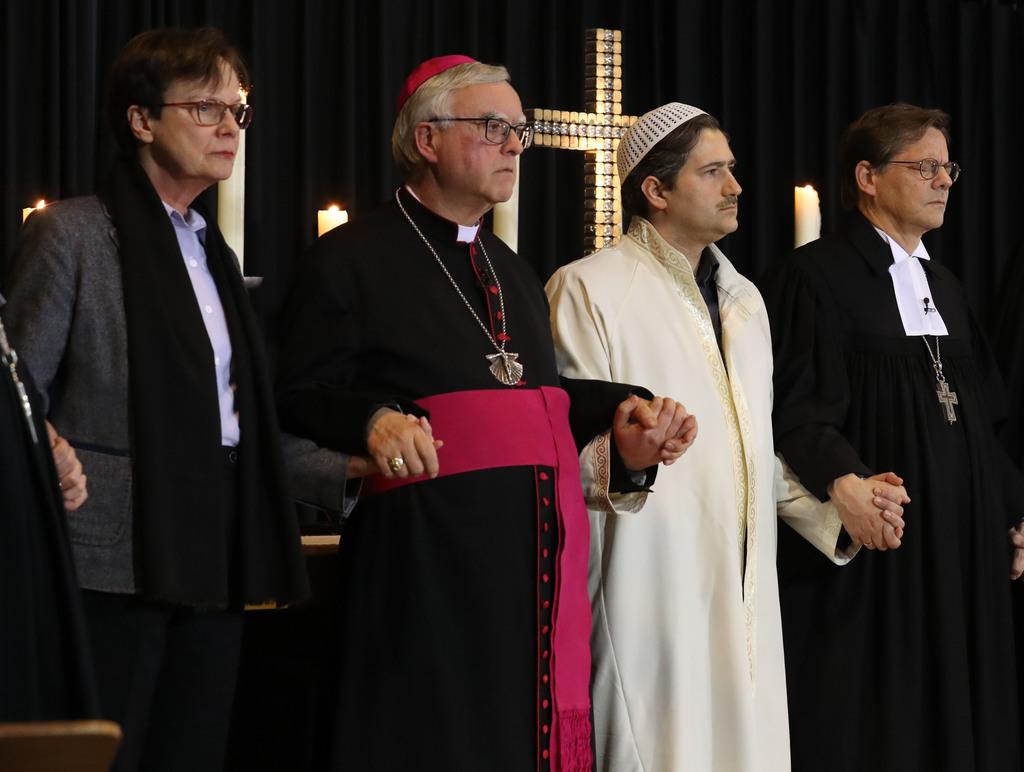 From left: Ulrike Trautwein of the Evangelican church, Archbishop of Berlin, Heiner Koch, Imam Kadir Sanci, and Bischop Markus Droege h...