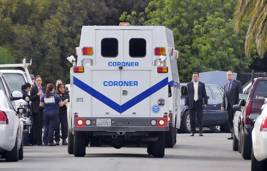 Officials investigate a home in the Lennox area of Los Angeles as they search for Lisa Marie Naegle, Tuesday, Dec. 20, 2016. Los Angele...