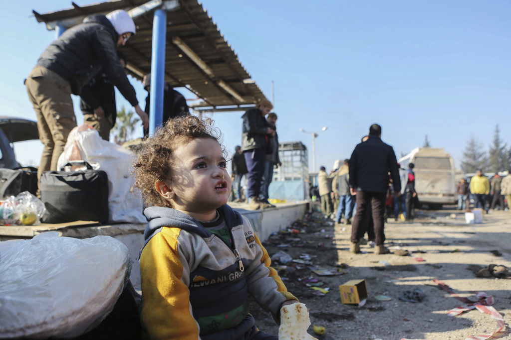 A Syrian child evacuated from the embattled Syrian city of Aleppo during the ceasefire arrives at a refugee camp in Rashidin, near Idli...