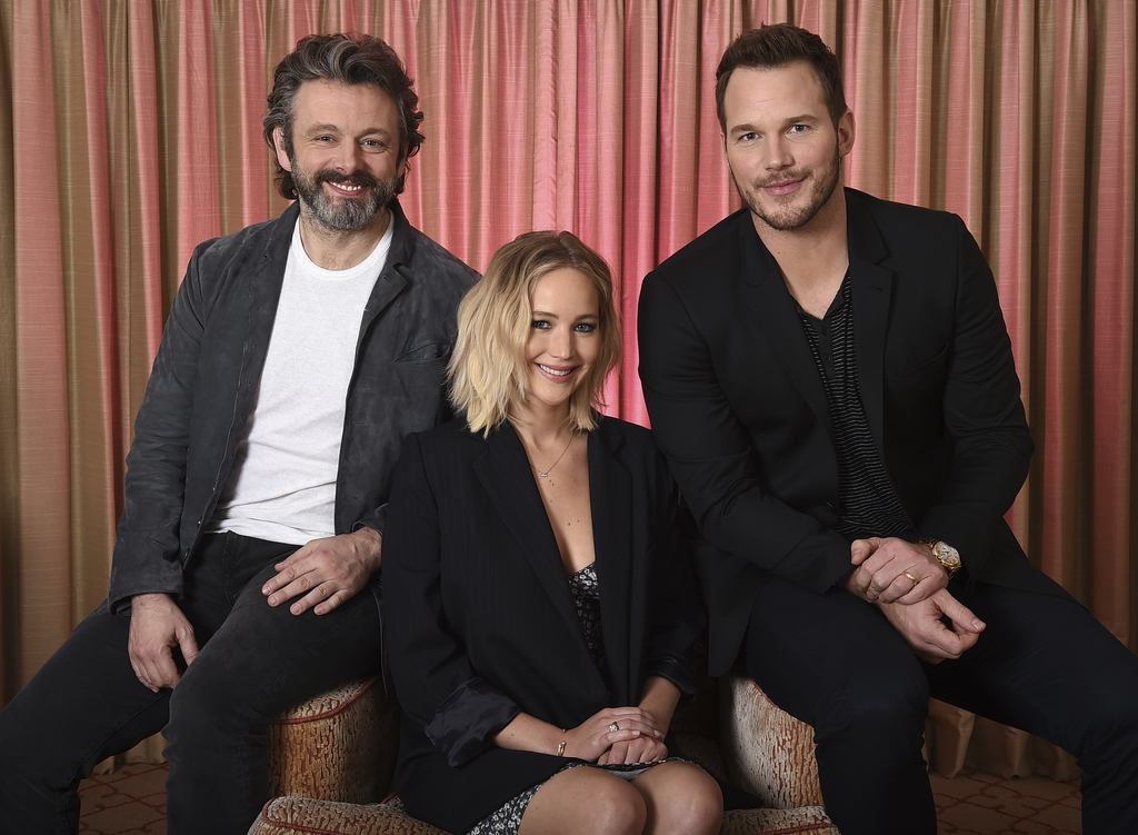 This Dec. 9, 2016 file photo shows, from left, Michael Sheen, Jennifer Lawrence and Chris Pratt during a portrait session for their upc...