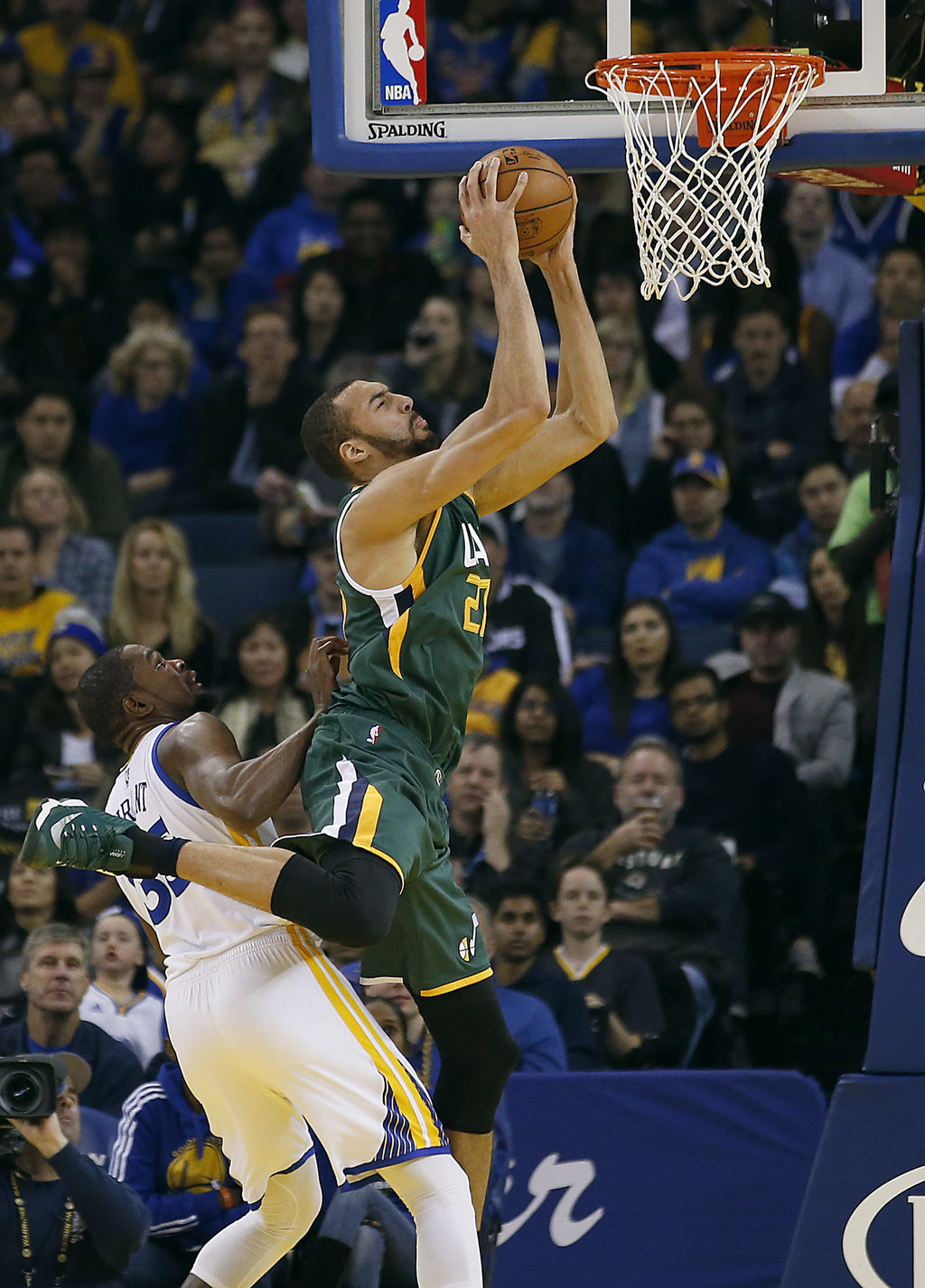 Utah Jazz center Rudy Gobert, right, is fouled from behind by Golden State Warriors forward Kevin Durant (35) during the first half of ...