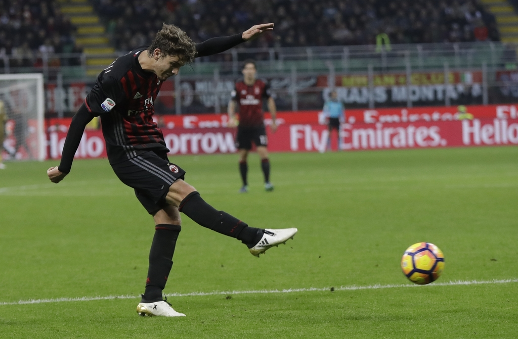 FILE - In this Saturday, Oct. 22, 2016 file photo, AC Milan's Manuel Locatelli scores during a Serie A soccer match between AC Milan an...