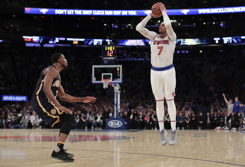 New York Knicks forward Carmelo Anthony (7) puts up a 3-point shot against Indiana Pacers forward Thaddeus Young during the fourth quar...