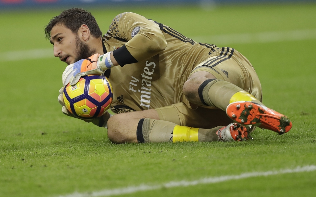 In this photo taken on Saturday, Oct. 22, 2016, AC Milan goalkeeper Gianluigi Donnarumma stops the ball during a Serie A soccer match b...