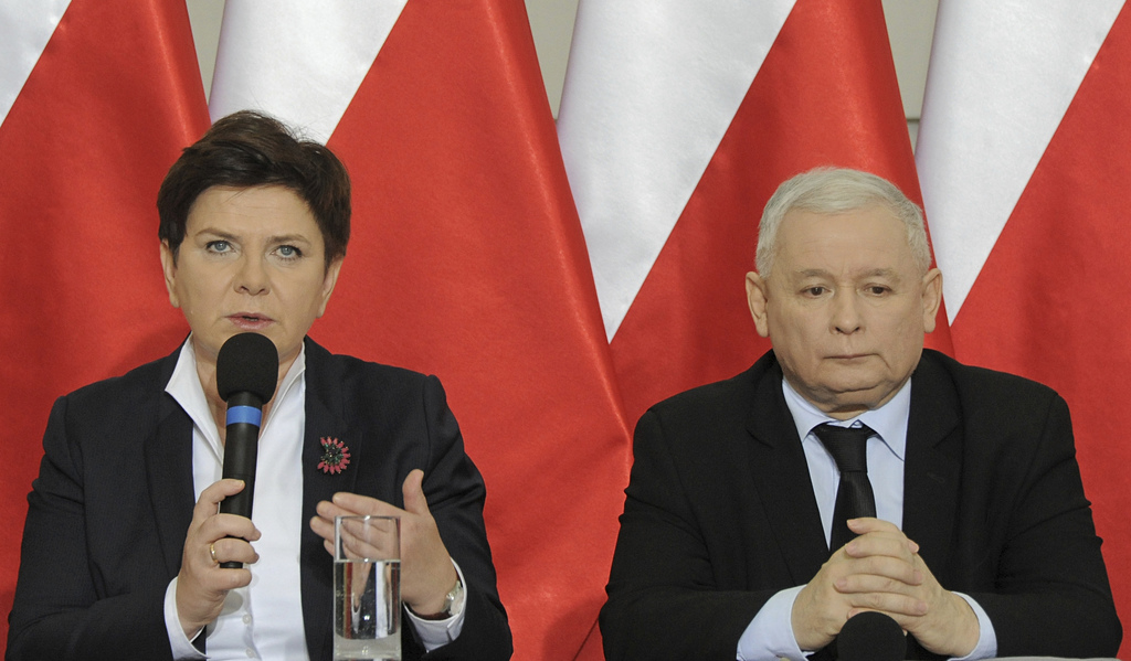 Jaroslaw Kaczynski, chairman of the populist ruling Law and Justice party, looks on during a press conference as Poland's Prime Ministe...