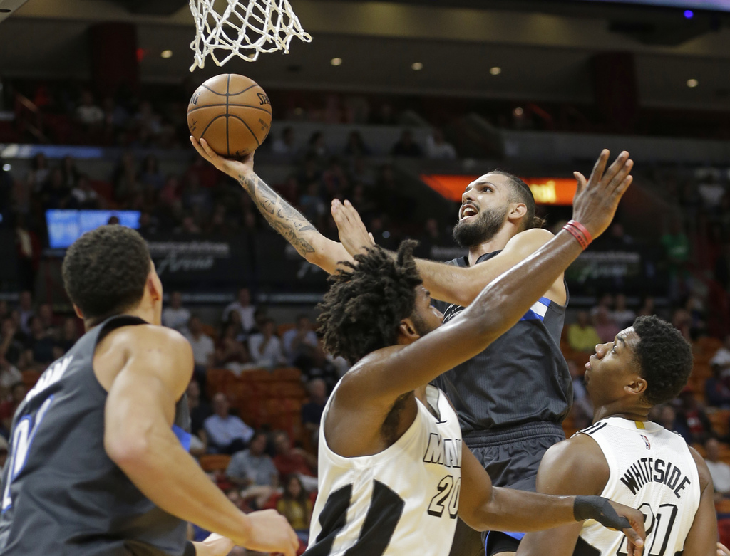 Orlando Magic guard Evan Fournier goes to the basket against the Miami Heat in the first half of of an NBA basketball game, Tuesday, De...