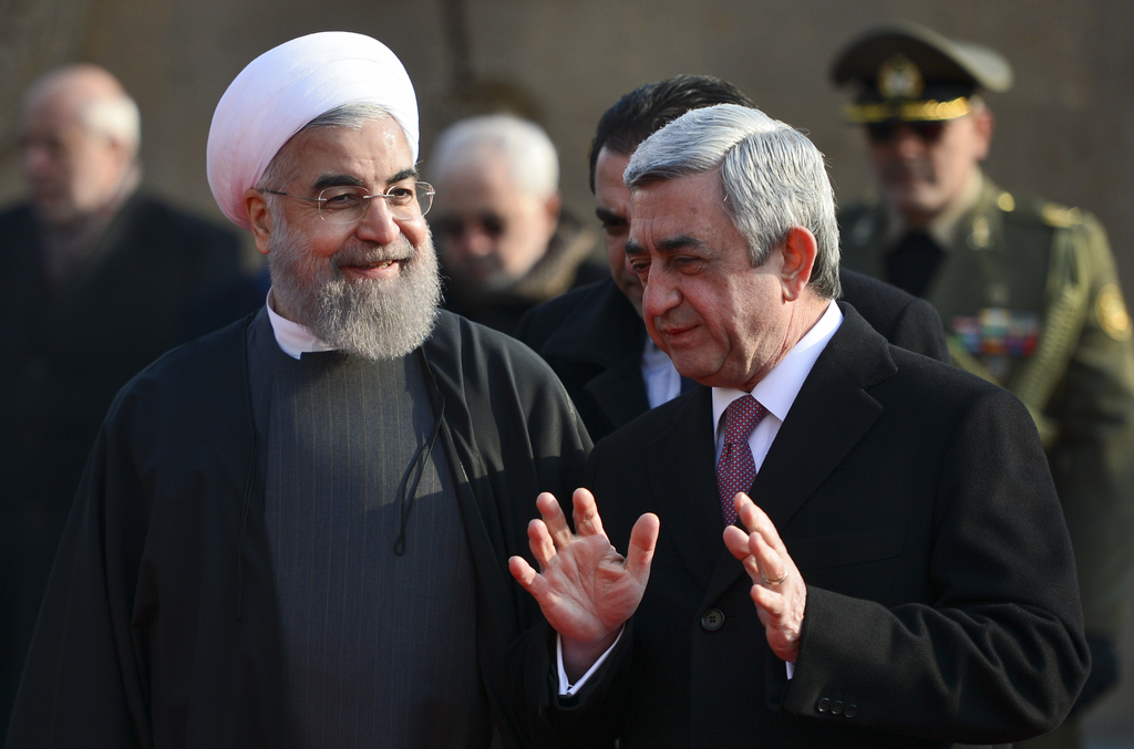 Armenian President Serzh Sargsyan, right, gestures while speaking to Iranian President Hassan Rouhani, during an official welcome cerem...