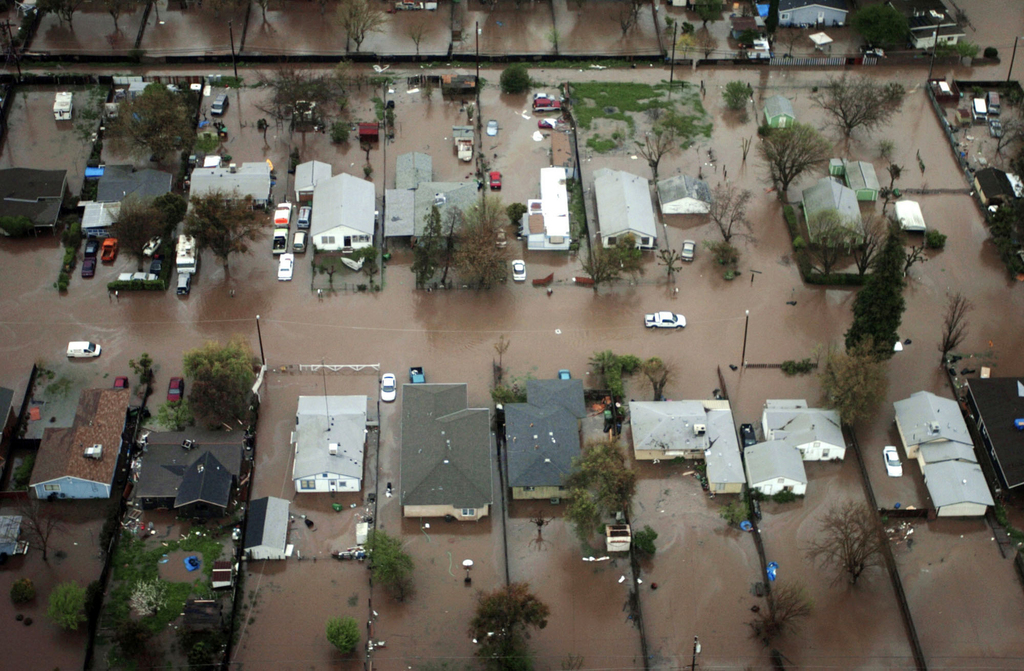 FILE - In this April 4, 2006 file photo, parts of the Beachwood-Franklin neighborhood in Merced, Calif., are seen after being flooded f...