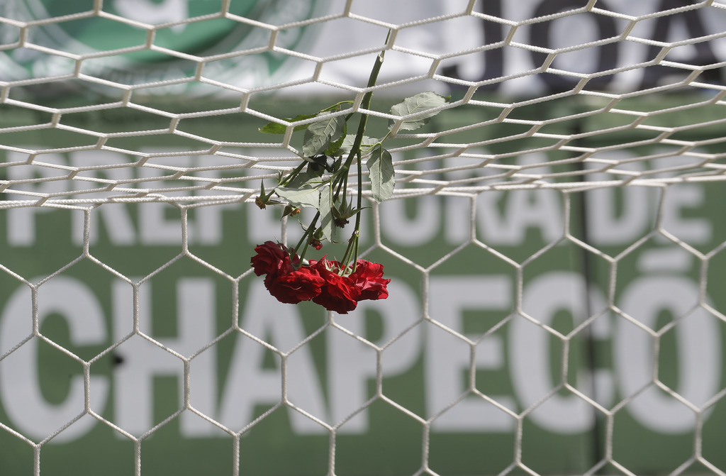FILE - In this Nov. 29, 2016 file photo, flowers hang from a soccer net at the Arena Conda stadium in Chapeco, Brazil. Colombia and Bra...