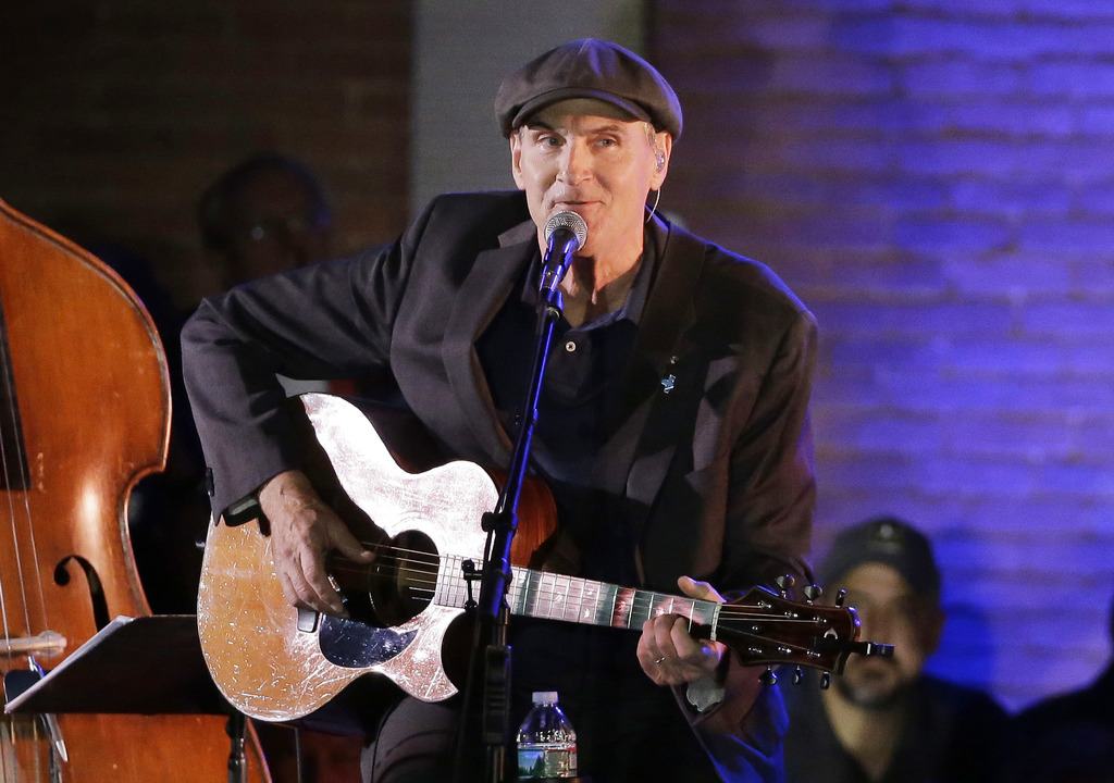 In this Sunday, Nov. 6, 2016, file photo, musician James Taylor performs in Manchester, New Hampshire. James Taylor has canceled his Fe...