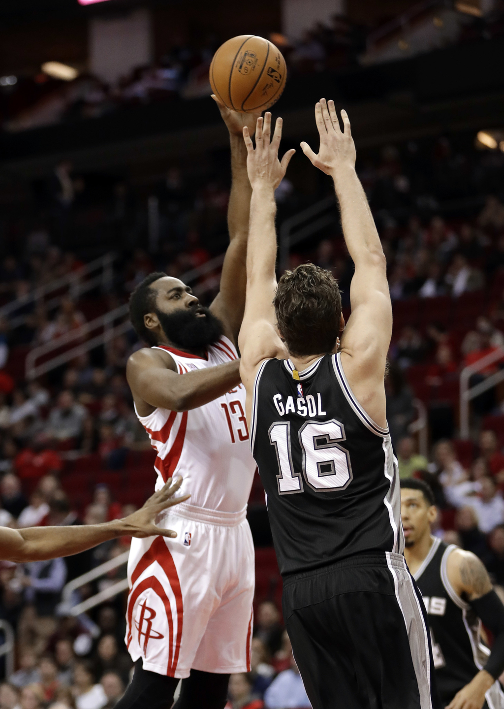 Houston Rockets' James Harden (13) shoots as San Antonio Spurs' Pau Gasol (16) defends during the first half of an NBA basketball game ...