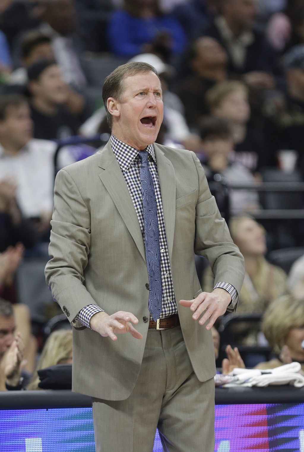 Portland Trail Blazers coach Terry Stotts yells about a foul call during the first quarter of the team's NBA basketball game against th...
