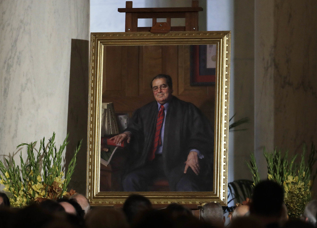 FILE - In this Friday, Nov. 4, 2016 file photo, a portrait of the late Supreme Court Justice Antonin Scalia is displayed during a memor...