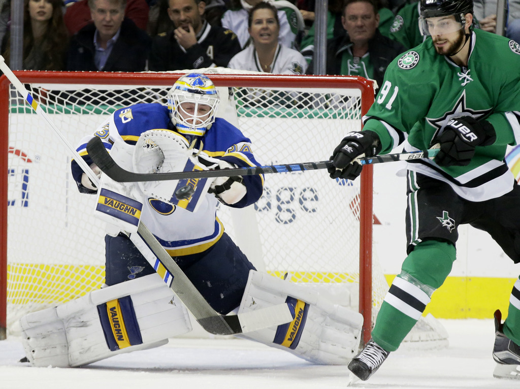 St. Louis Blues goalie Jake Allen (34) defends the goal against Dallas Stars center Tyler Seguin (91) during the first period of an NHL...