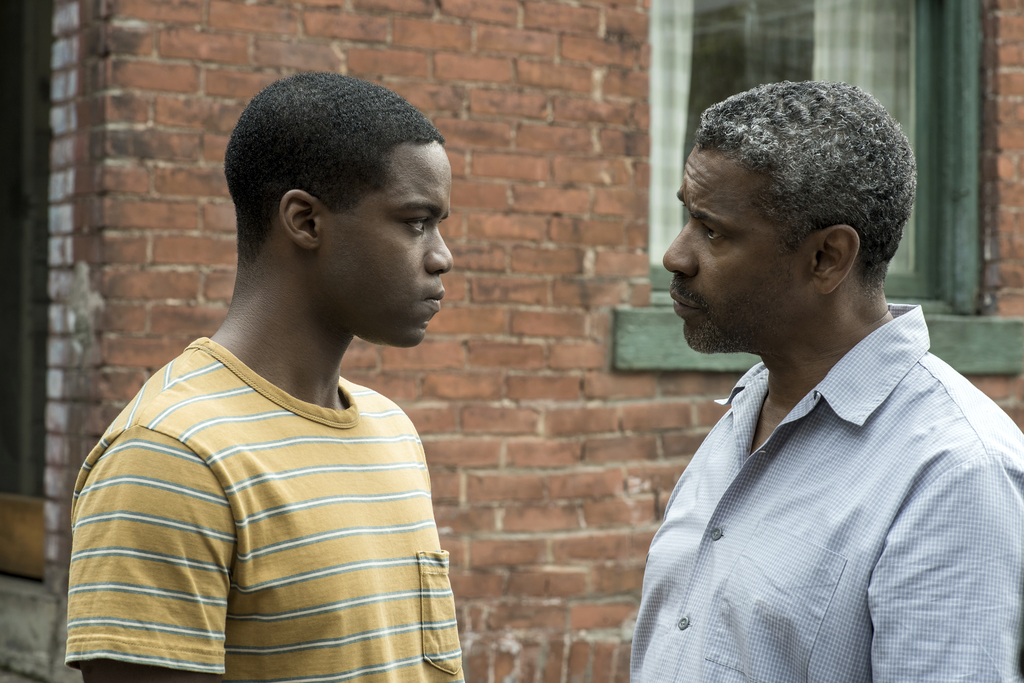 """This image released by Paramount Pictures shows Jovan Adepo, left, and Denzel Washington in a scene from """"Fences."""" (David Lee/Paramount..."""