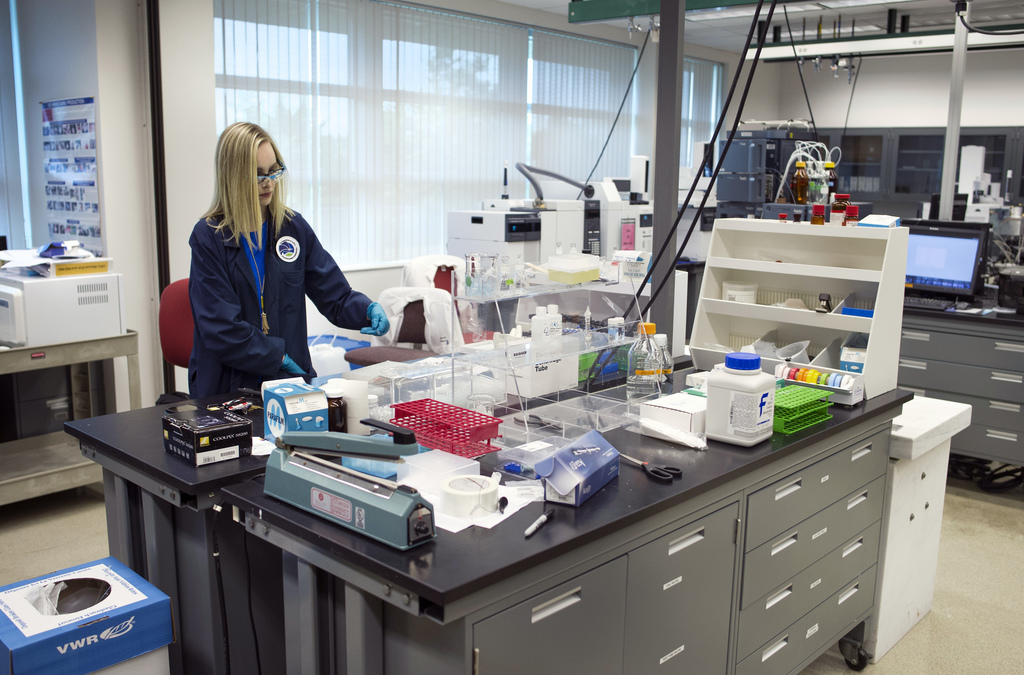 In this Aug. 9, 2016 photo, Forensic Chemist Emily Dye works at the Drug Enforcement Administration (DEA) Special Testing and Research ...