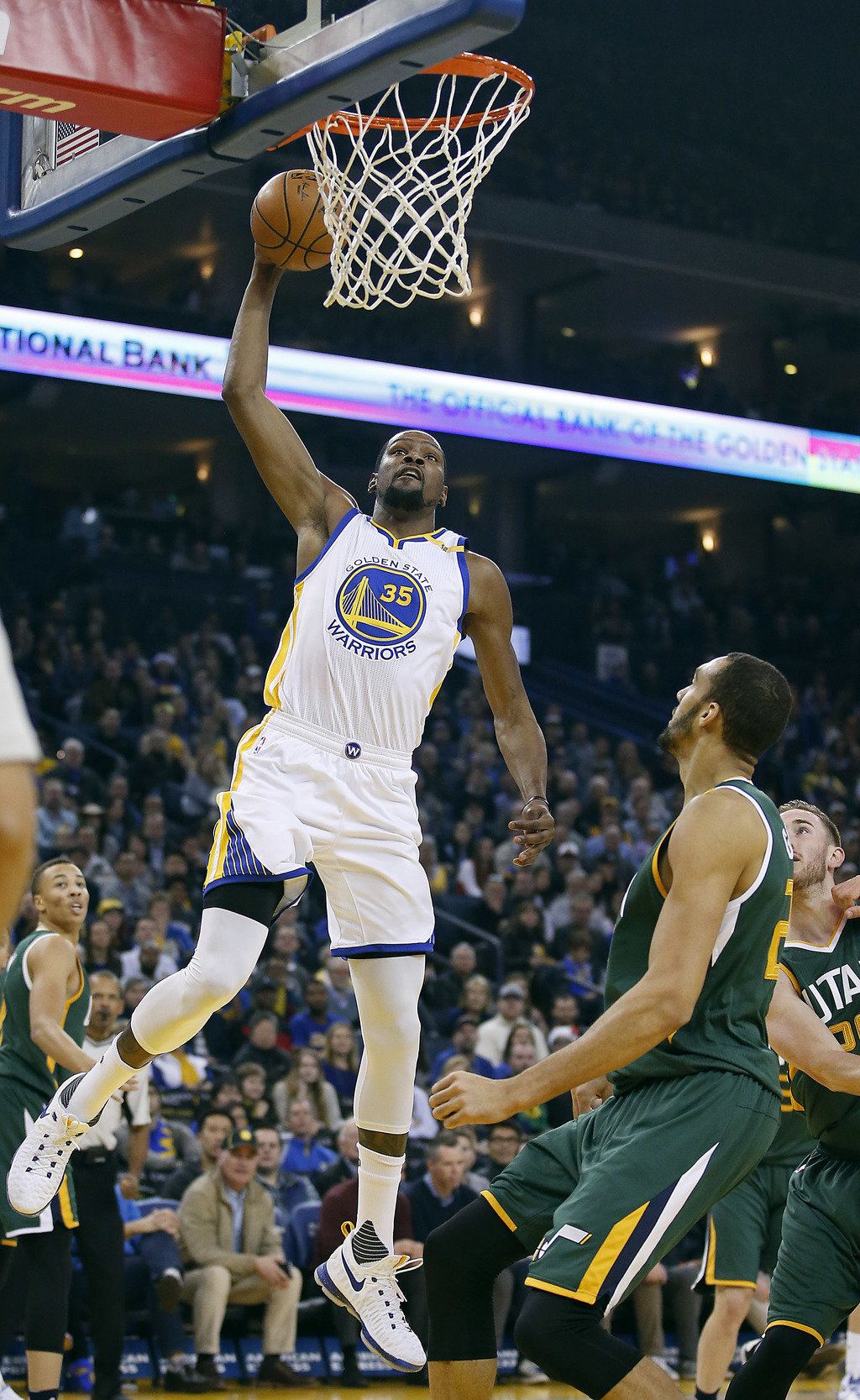 Golden State Warriors forward Kevin Durant (35) dunks in front of Utah Jazz center Rudy Gobert, right, during the first half of an NBA ...