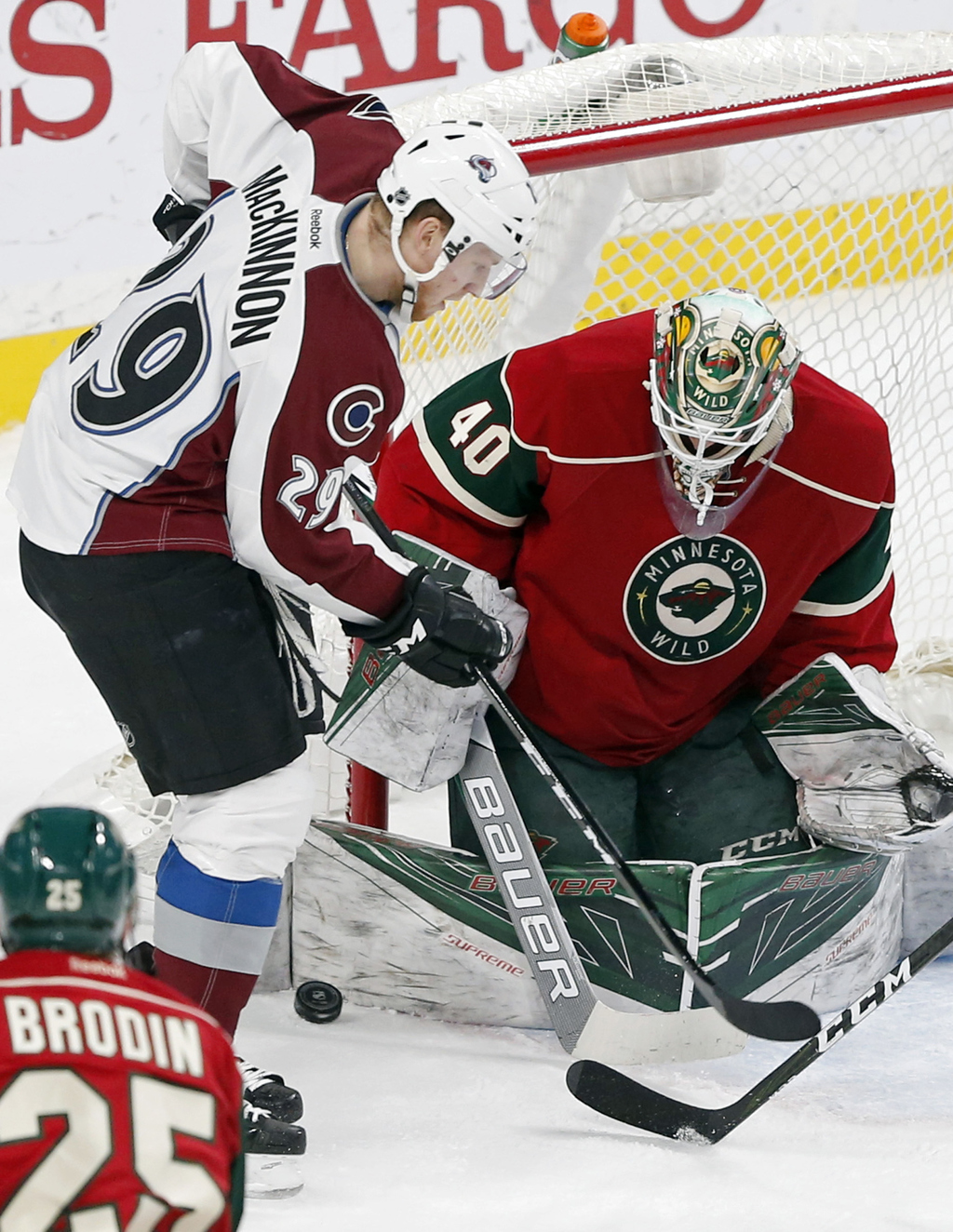 Minnesota Wild goalie Devan Dubnyk, right, blocks a scoring threat by Colorado Avalanche's Nathan MacKinnon during the second period of...