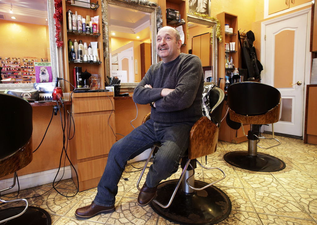 In this Dec. 16, 2016 photo, Yefim Kacher, owner of a Brighton Beach hair salon in the Brooklyn borough of New York, talks about the el...