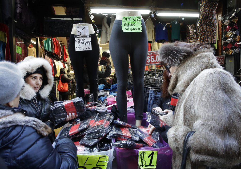 In this Dec. 16, 2016 photo, women choose stockings for sale in a Brighton Beach clothing store in the Brooklyn borough of New York. Mo...