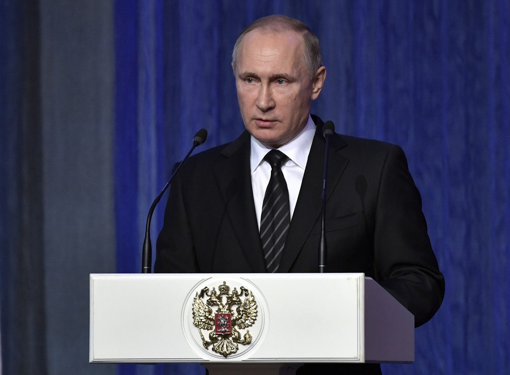 Russian President Vladimir Putin speaks at an annual meeting marking a professional holiday for Russian security service employees in M...
