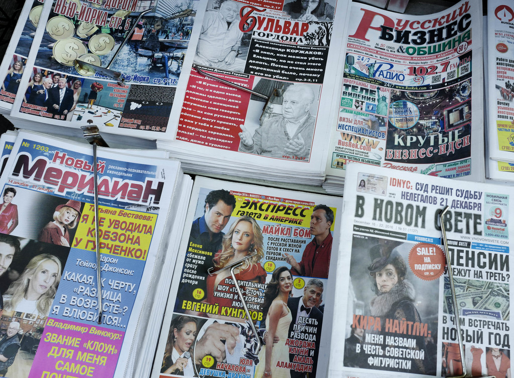 In this Dec. 16, 2016 photo, Russian-language newspapers are displayed on a Brighton Beach newsstand in the Brooklyn borough of New Yor...