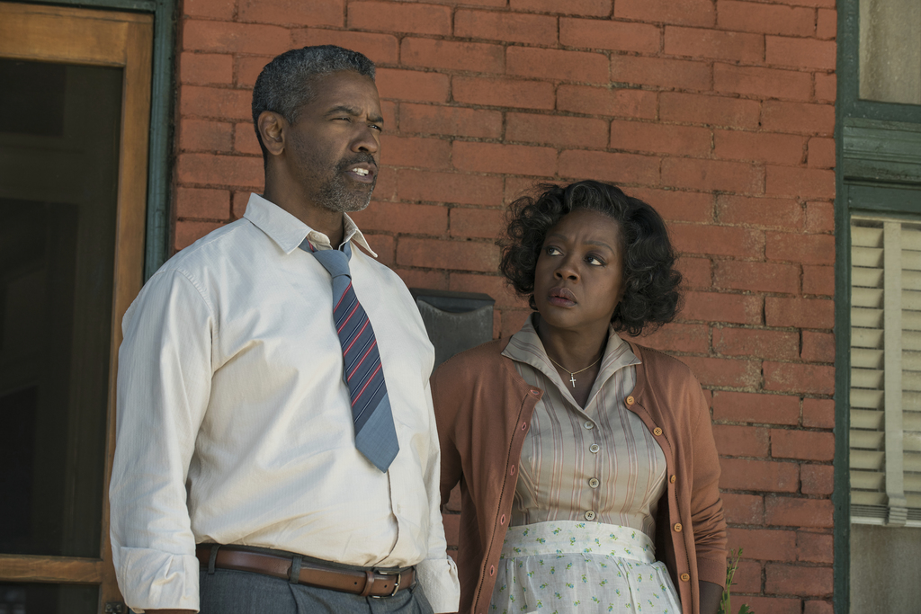 """This image released by Paramount Pictures shows Denzel Washington, left, and Viola Davis in a scene from """"Fences,"""" directed by Washingt..."""