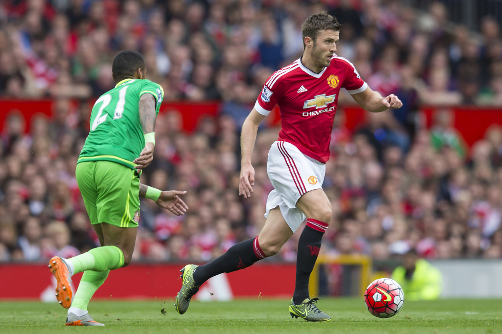 FILE - This is a Saturday, Sept. 26, 2015  file photo of Manchester United's Michael Carrick, right, as he fights for the ball against ...