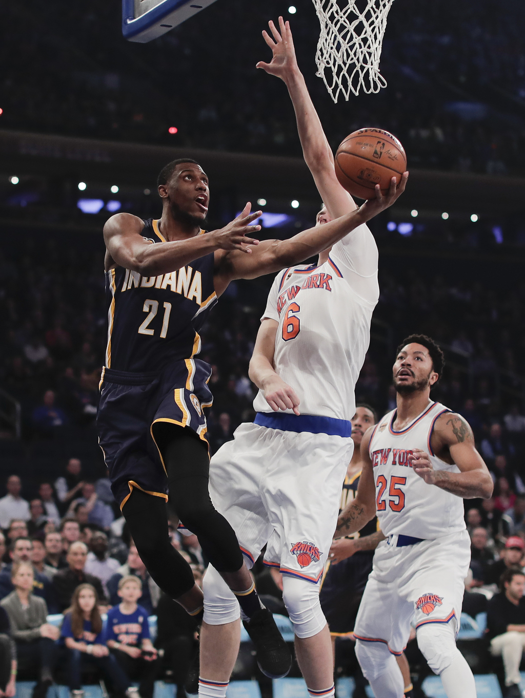 Indiana Pacers forward Thaddeus Young (21) shoots against New York Knicks forward Kristaps Porzingis (6) during the first quarter of an...