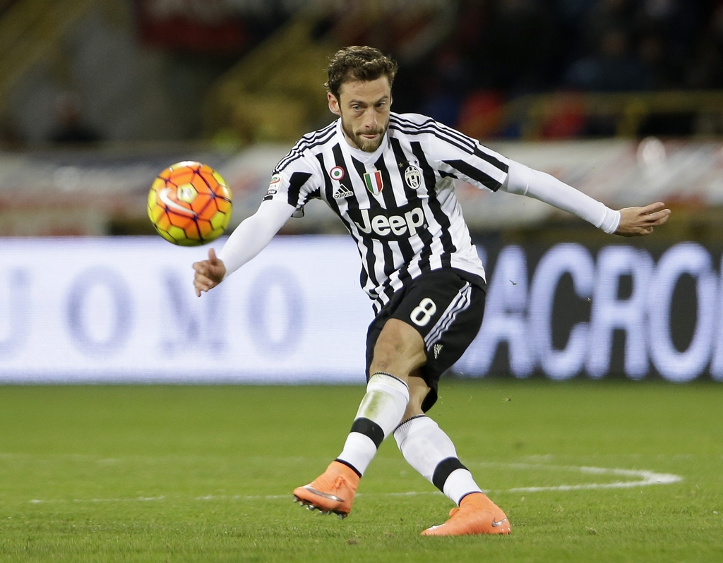 FILE - In this Friday, Feb. 19, 2016 filer, Juventus' Claudio Marchisio kicks the ball during the Serie A soccer match between Bologna ...