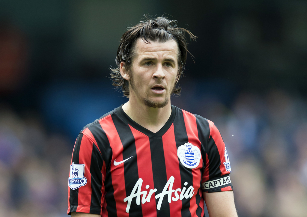 FILE - In this Sunday, May 10, 2015 file photo, Queens Park Rangers' Joey Barton watches the ball during their English Premier League s...