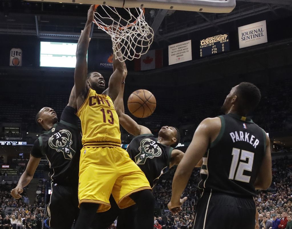 Cleveland Cavaliers' Tristan Thompson dunks during the first half of an NBA basketball game against the Milwaukee Bucks Tuesday, Dec. 2...