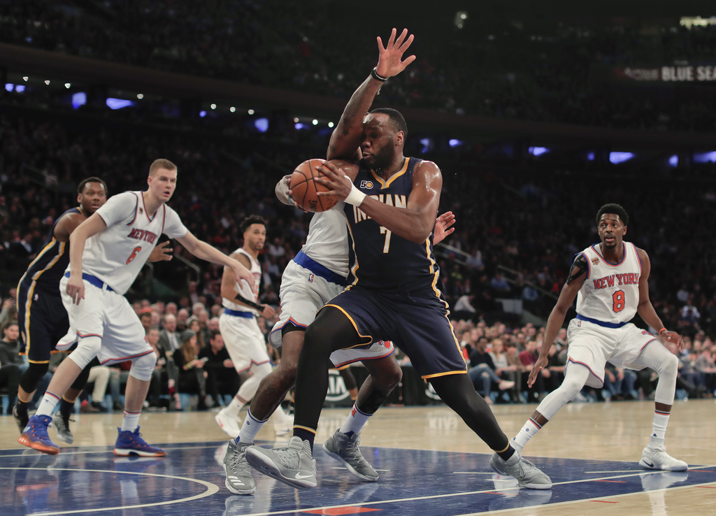 Indiana Pacers center Al Jefferson (7) drives against New York Knicks center Kyle O'Quinn during the second quarter of an NBA basketbal...
