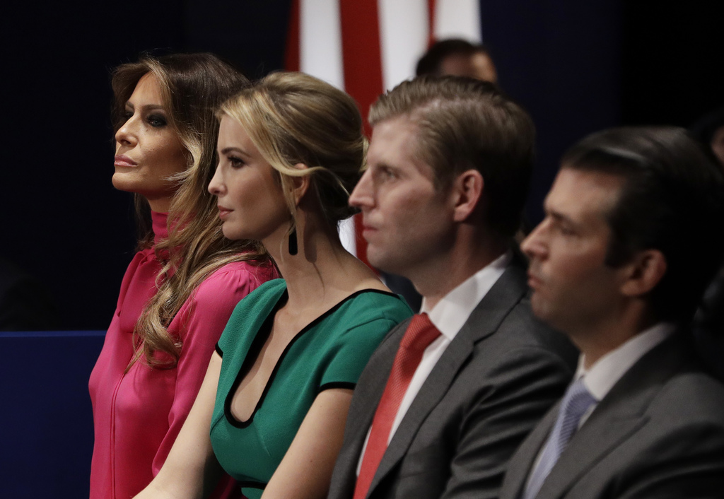FILE - In this Sunday, Oct. 9, 2016 file photo, from left, Melania Trump, Ivanka Trump, Eric Trump and Donald Trump, Jr. wait for the s...