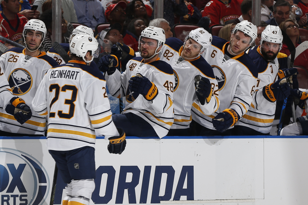 Teammates congratulate Buffalo Sabres center Sam Reinhart (23) after he scored a goal against the Florida Panthers during the second pe...