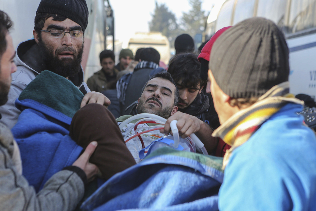 An injured Syrian arrives at a refugee camp in Rashidin, near Idlib, Syria, after was evacuated from the embattled Syrian city of Alepp...