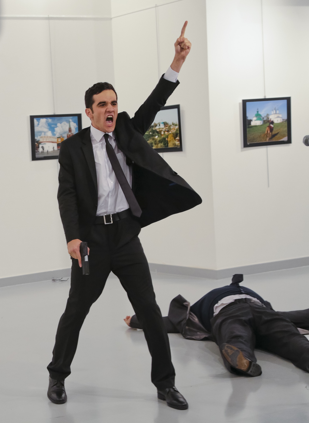 FILE - In this Monday, Dec. 19, 2016 file photo, Mevlut Mert Altintas shouts after shooting Andrei Karlov, right, the Russian ambassado