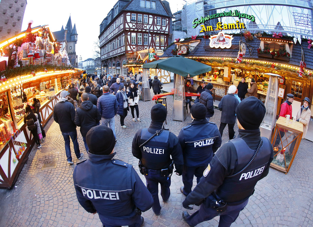 German police officers patrol over the Christmas market in Frankfurt, Germany, Tuesday, Dec. 20, 2016. (AP Photo/Michael Probst)       ...