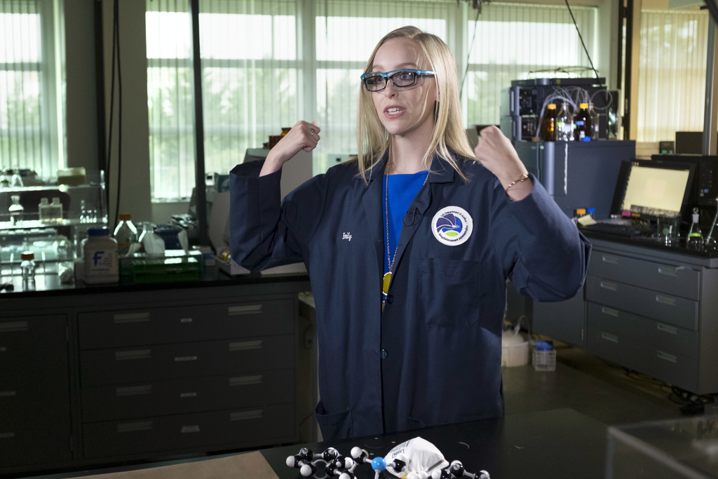 In this Aug. 9, 2016, photo, forensic chemist Emily Dye talks about protective measures she takes while handling evidence containing fe...