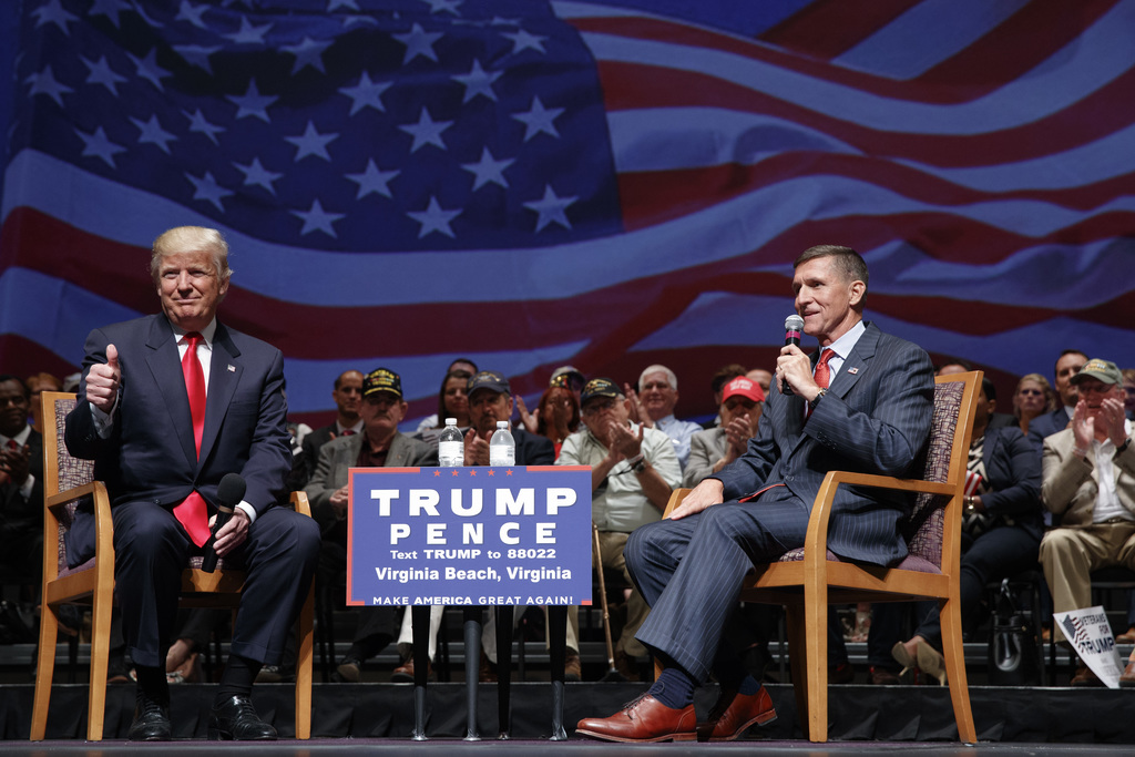FILE - In this Sept. 6, 2016, file photo, then Republican presidential candidate Donald Trump gives a thumbs-up as he speaks with retir...