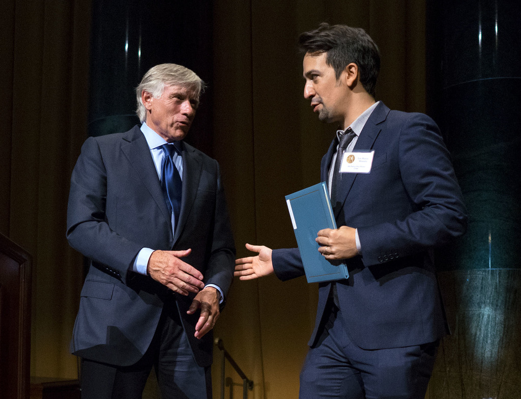 FILE - In this Oct. 13, 2016 file photo Columbia University President Lee Bollinger, left, reaches out to Lin-Manuel Miranda, who was r...