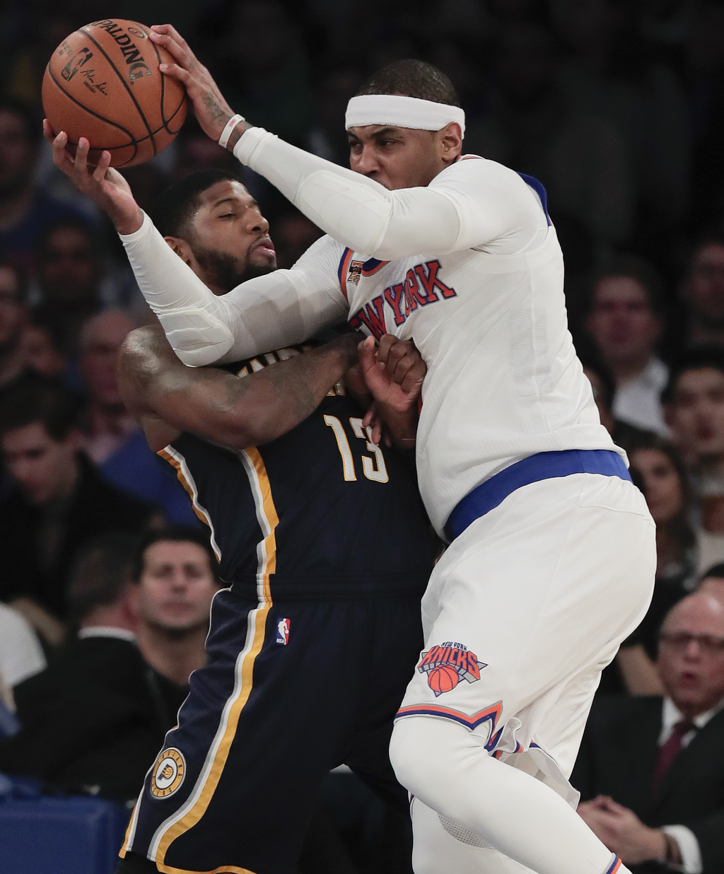 New York Knicks forward Carmelo Anthony drives against Indiana Pacers forward Paul George (13) during the first quarter of an NBA baske...