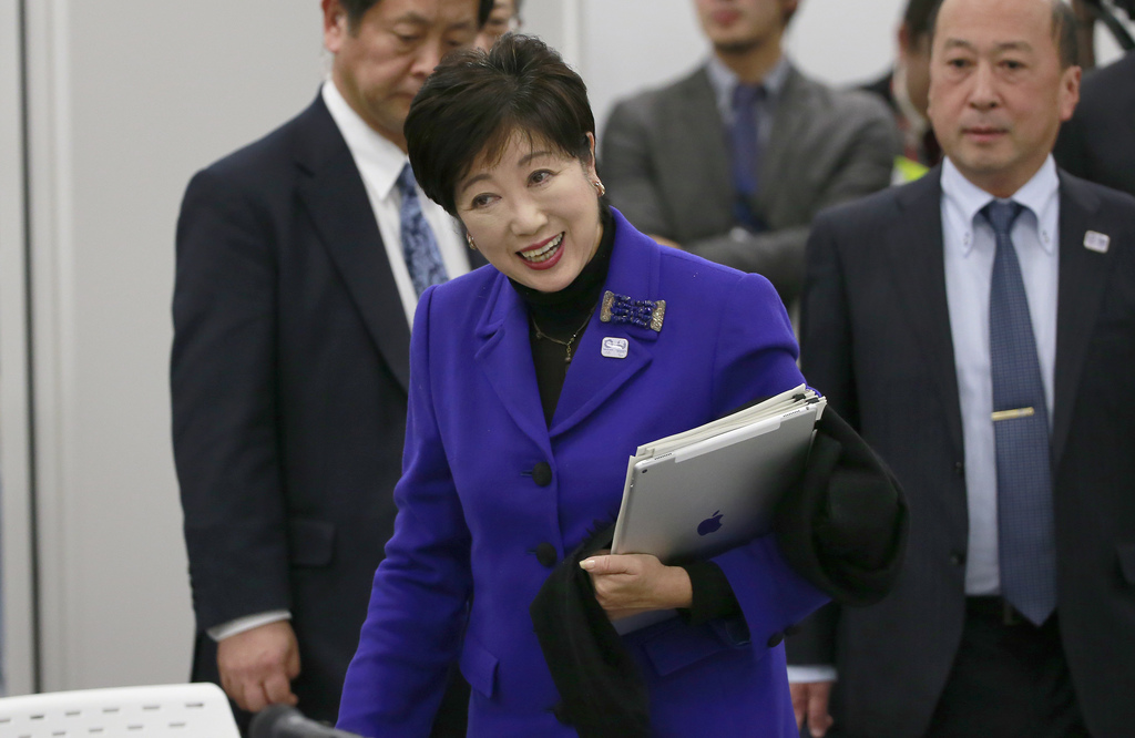 Tokyo Gov. Yuriko Koike arrives at the Four-Party Working Group meeting in Tokyo, Wednesday, Dec. 21, 2016. Japanese Olympic organizers...