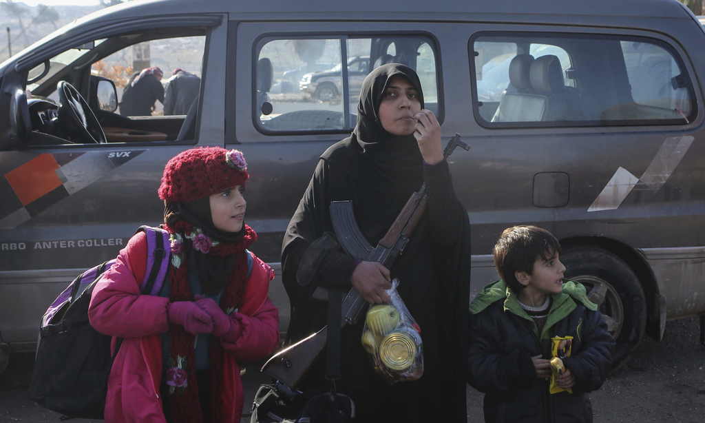 Syrians evacuated from the embattled Syrian city of Aleppo during the ceasefire arrive at a refugee camp in Rashidin, near Idlib, Syria...