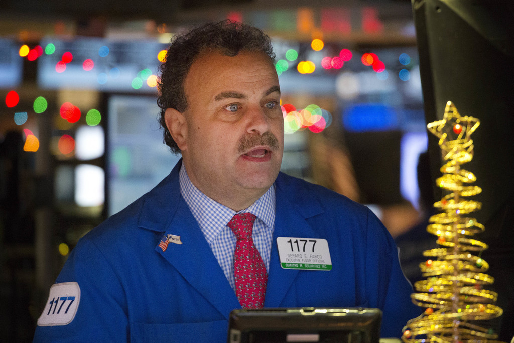 Gerard Farco follows stock prices at the New York Stock Exchange, Wednesday, Dec. 21, 2016, in New York. The Dow is close to the 20,000...